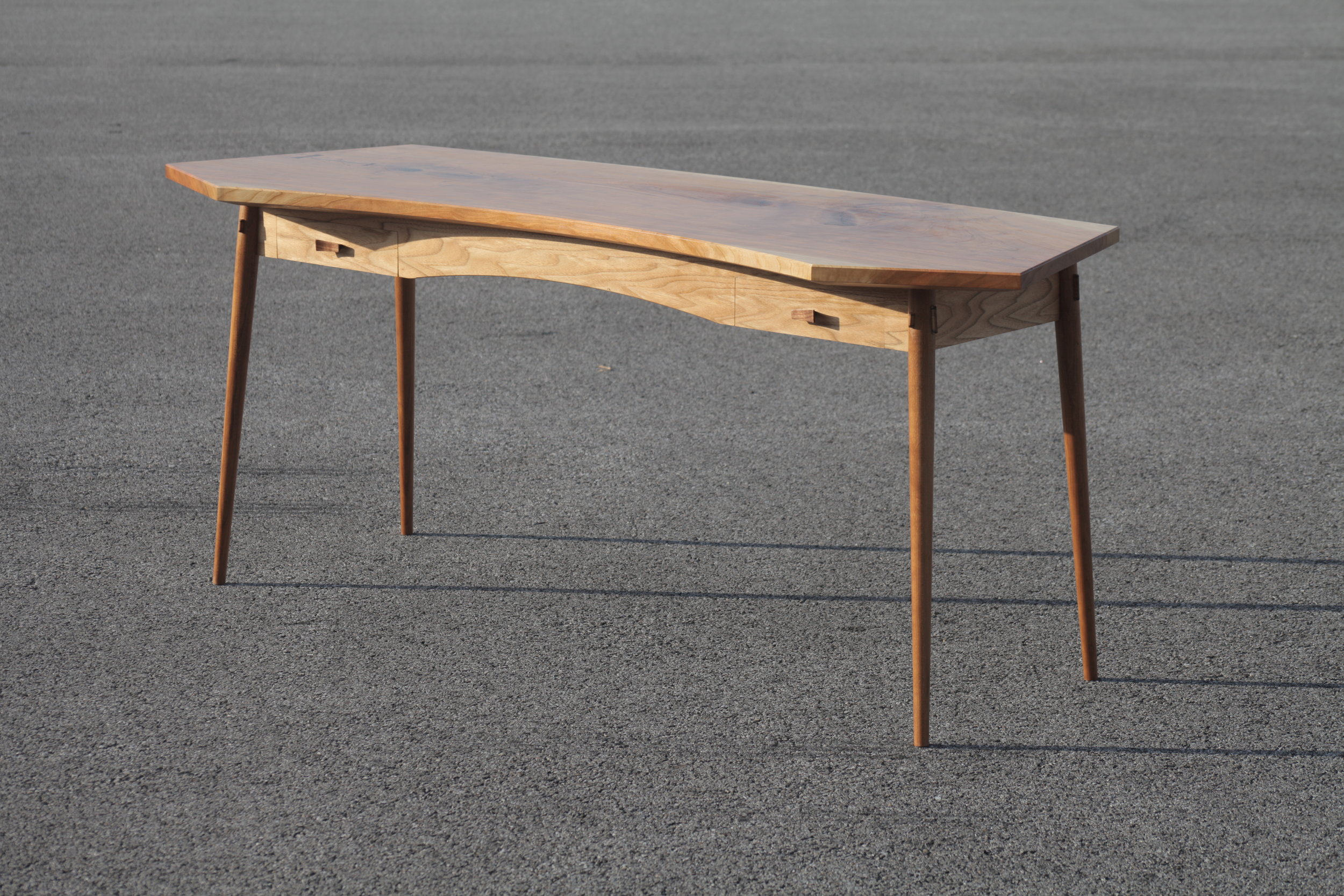 never-stop-building-curved-cherry-desk.jpg