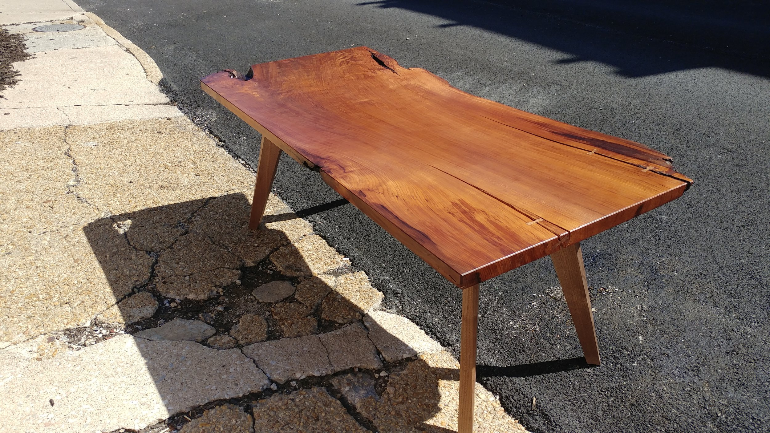 The comissioned table features a live edge.