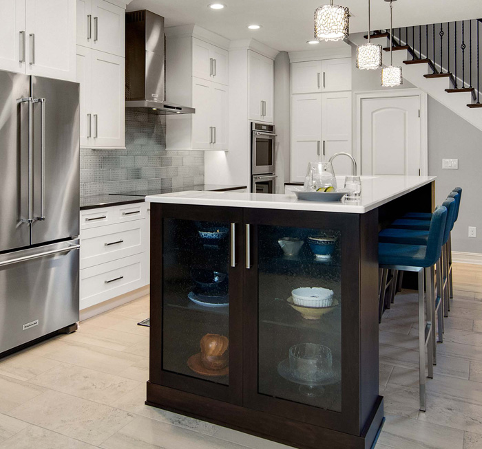 modern and chic kitchen featuring island and bar area