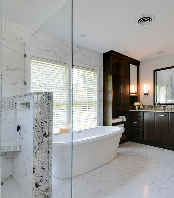 modern bathroom featuring marble and stand alone tub
