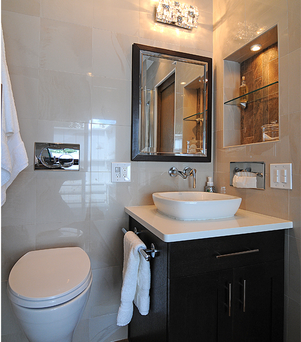 modern bathroom featuring wall to ceiling large tile