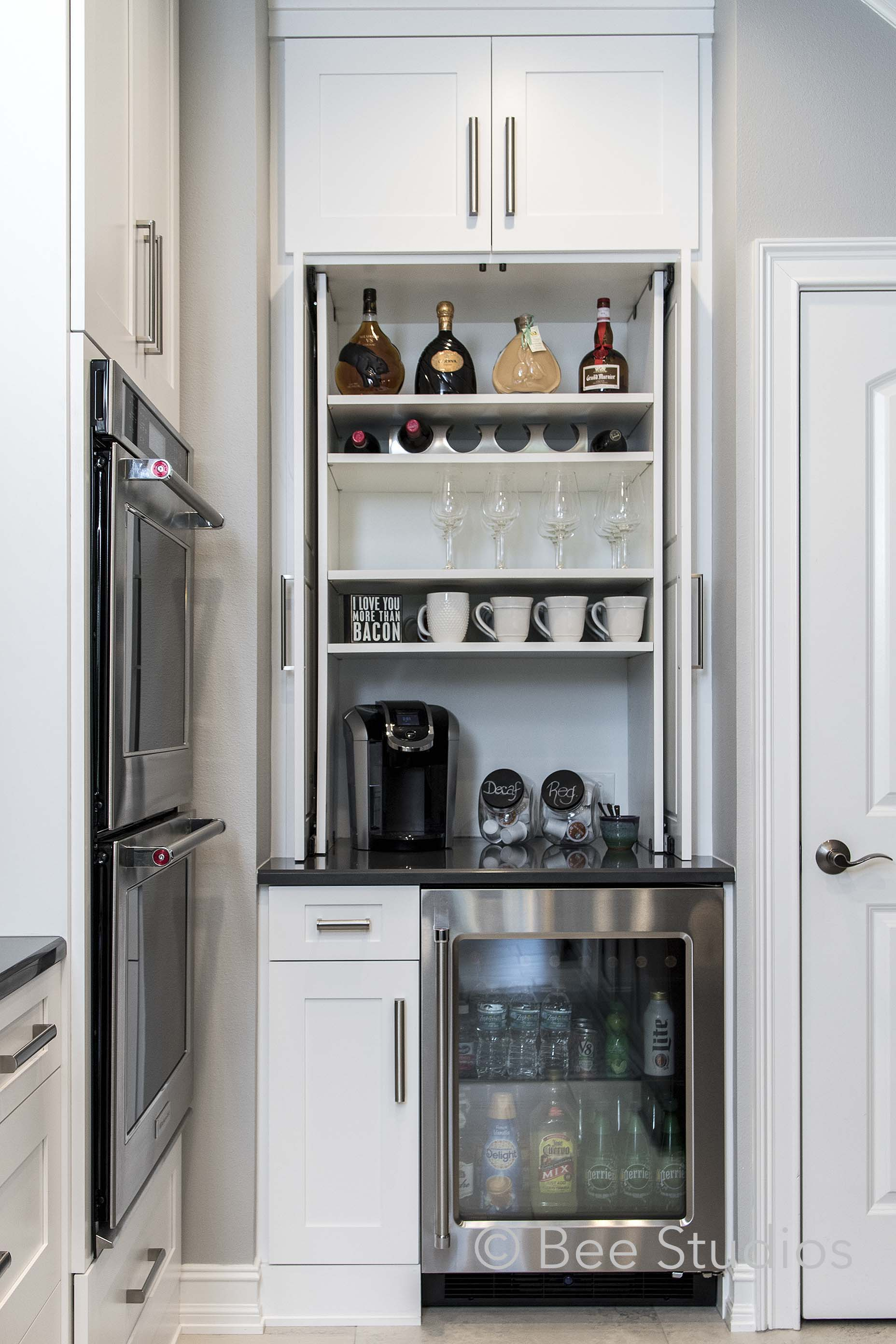 Bar storage in kitchen with wine fridge, bar fridge and coffee station
