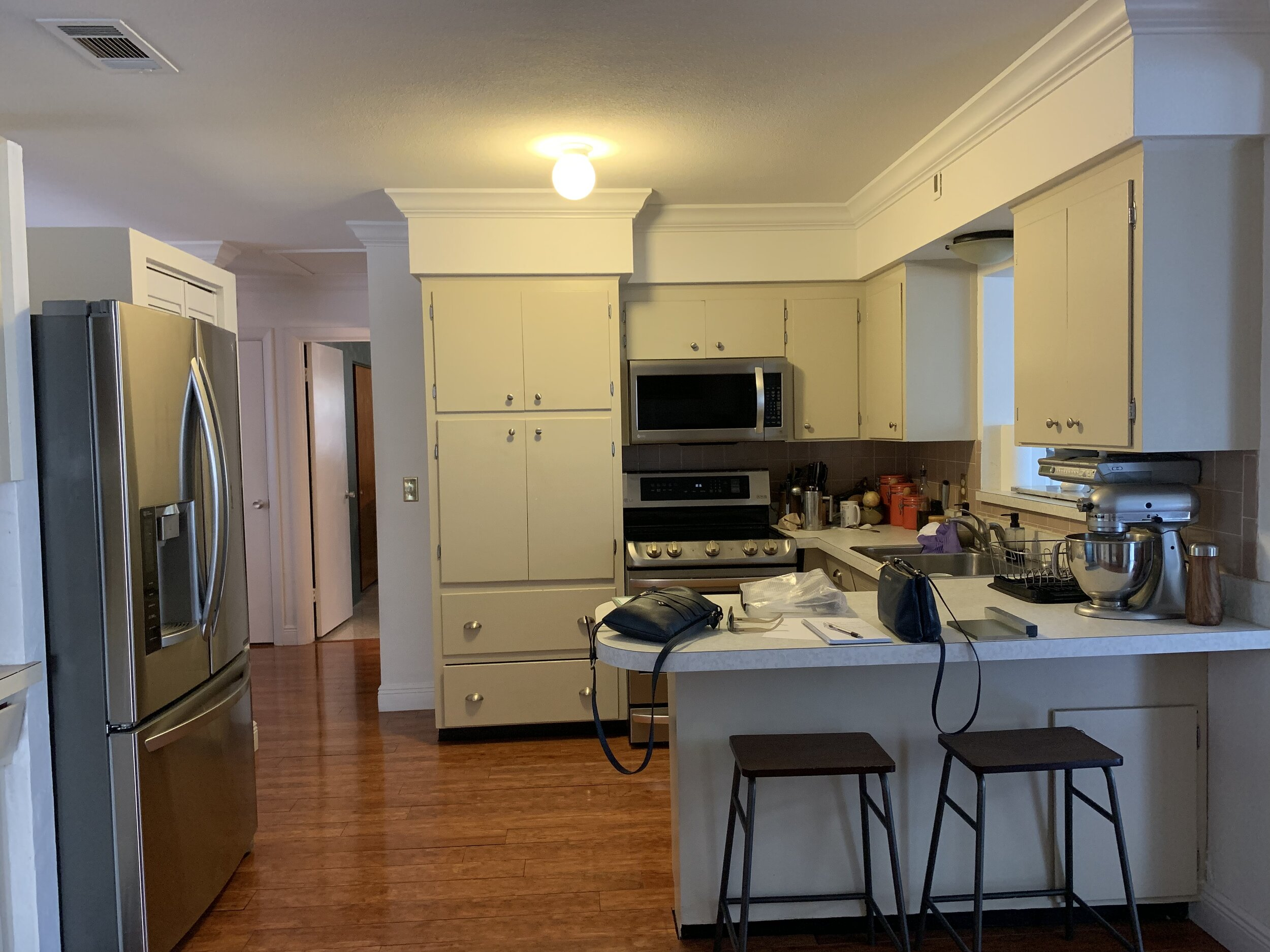 """The """"Original"""" kitchen of the house. Inadequate pantry, lack of proper drawers, and bad appliance placement."""