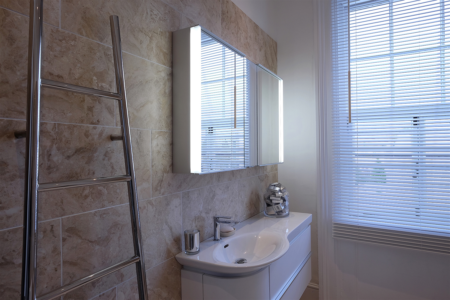 Marble bathroom wall tiles and heated towel rail