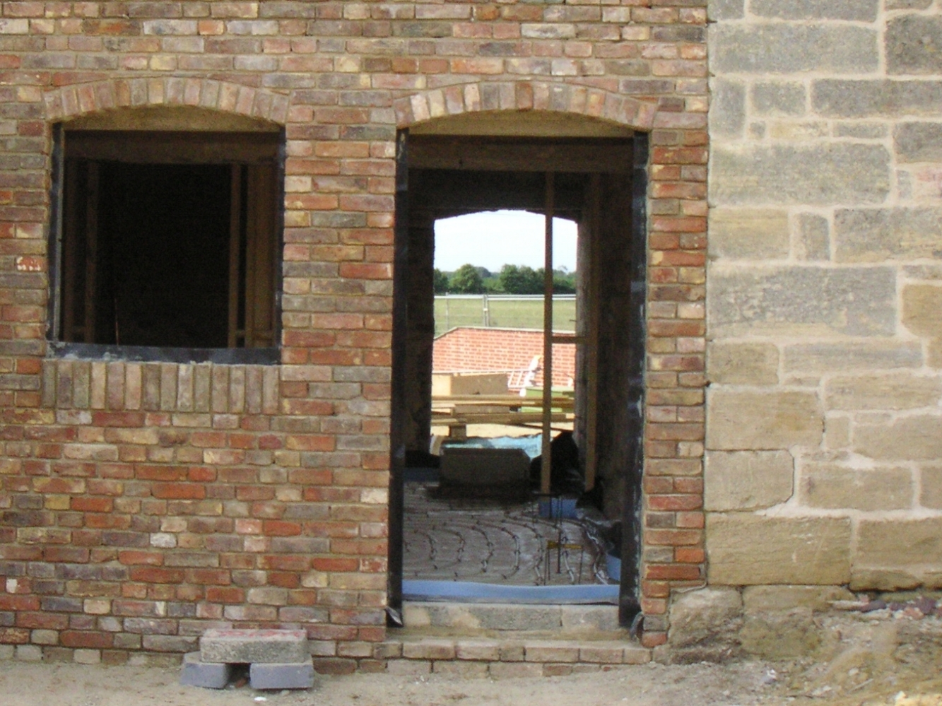 Entrance to barn conversion, repointing and cleaning exterior brick and stone work