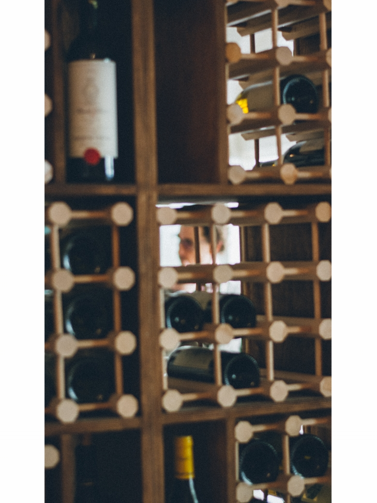 He built a structure where every guests could see every wine bottle from every angle.
