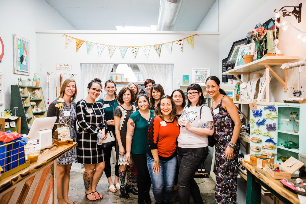 A holiday community event for women entrepreneurs at Strands of Sunshine in 2017. We raised funds for Girls Rock Camp's 2018 camp season and highlighted their mission. Photo by Jessica Fredericks Photography.