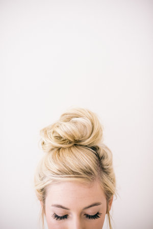 Women looking down with top knot