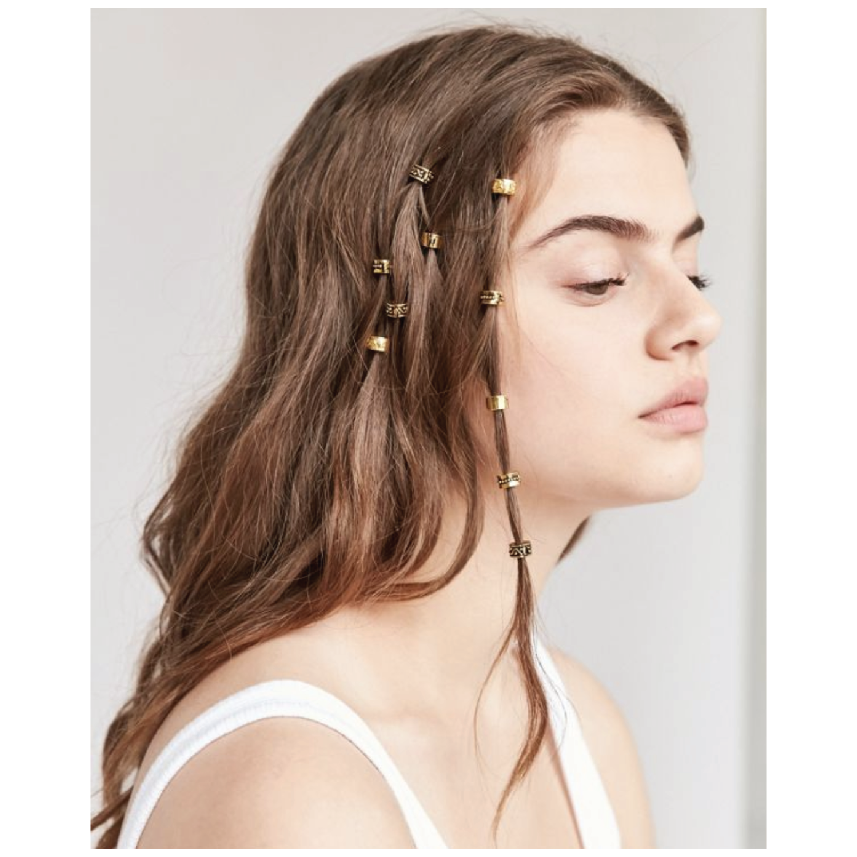 Regal Rose Engraved Hair Charm Set - $20 at Urban OutfittersThese charms look beautiful in any type of hair, and are the perfect unique accessory to spice up a look.