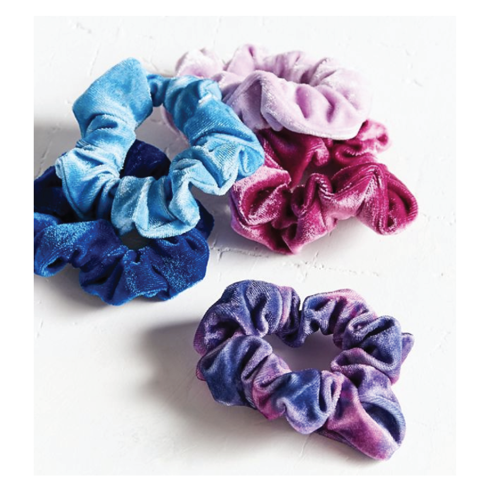 Velvet Hair Scrunchie Set - $12 on Urban OutfittersThe 90s are back people! Stuff your stocking with scrunchies this season.
