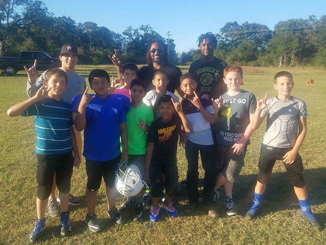 Cedric Benson teaches the Peewee Football League skill drills for a day.