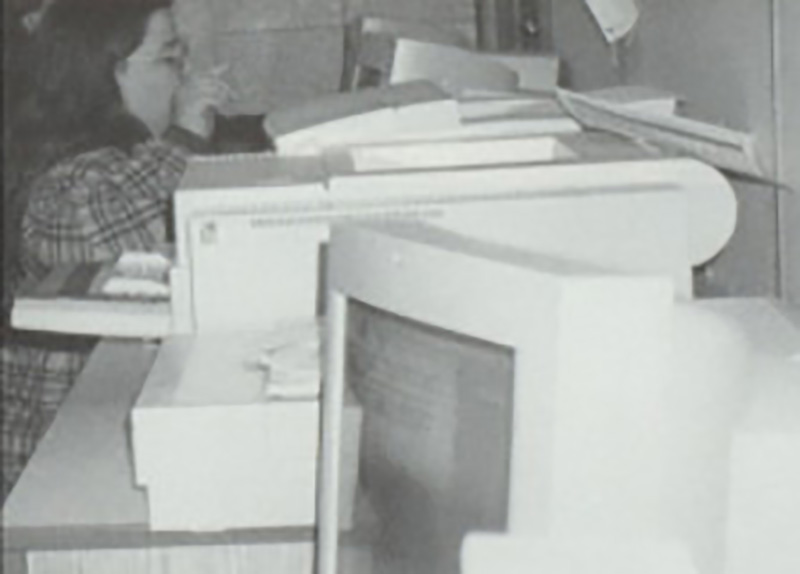That's me, behind all those Very New Computers, busily writing or designing newspaper pages, or from the looks of it, going on about something, circa 1996.  And at right is me today. Sadly, I no longer have access to those great computers, but I'm sure as you read this, I'm hard at work on something, and if you ask me about it, I bet I'll go on about it at length.