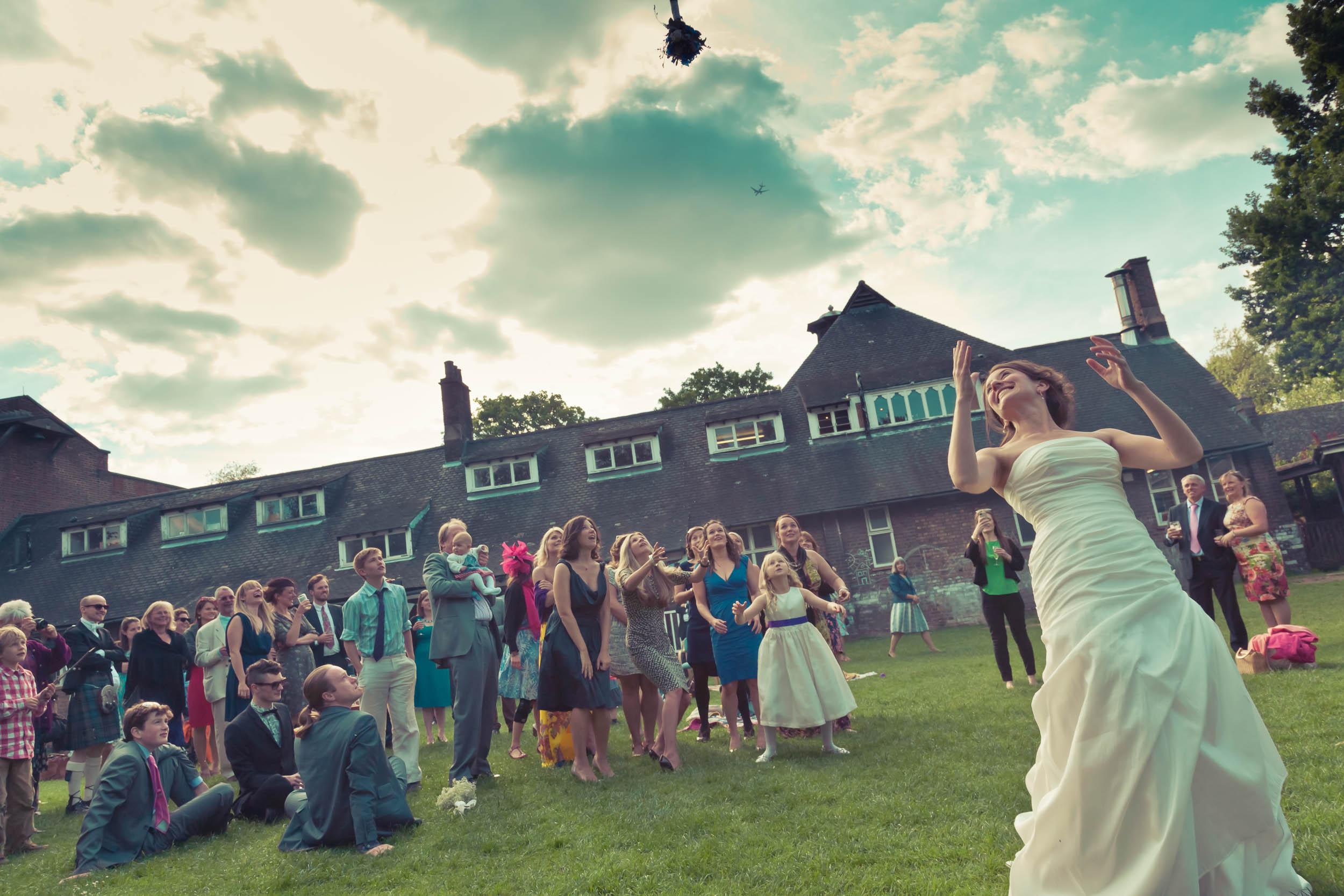 dulwich-wedding-bride-throwing-bouquet.jpg