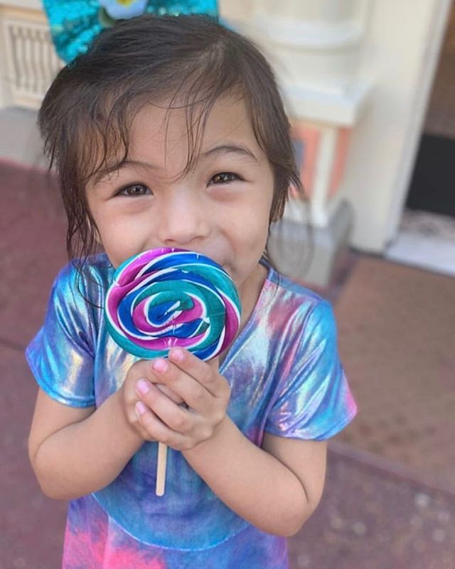 Look at this cutie in our spring rainbow dress!!! She wore it to Disney World and it is absolutely perfect! @nico.flourish you have some pretty amazing little girls 💜