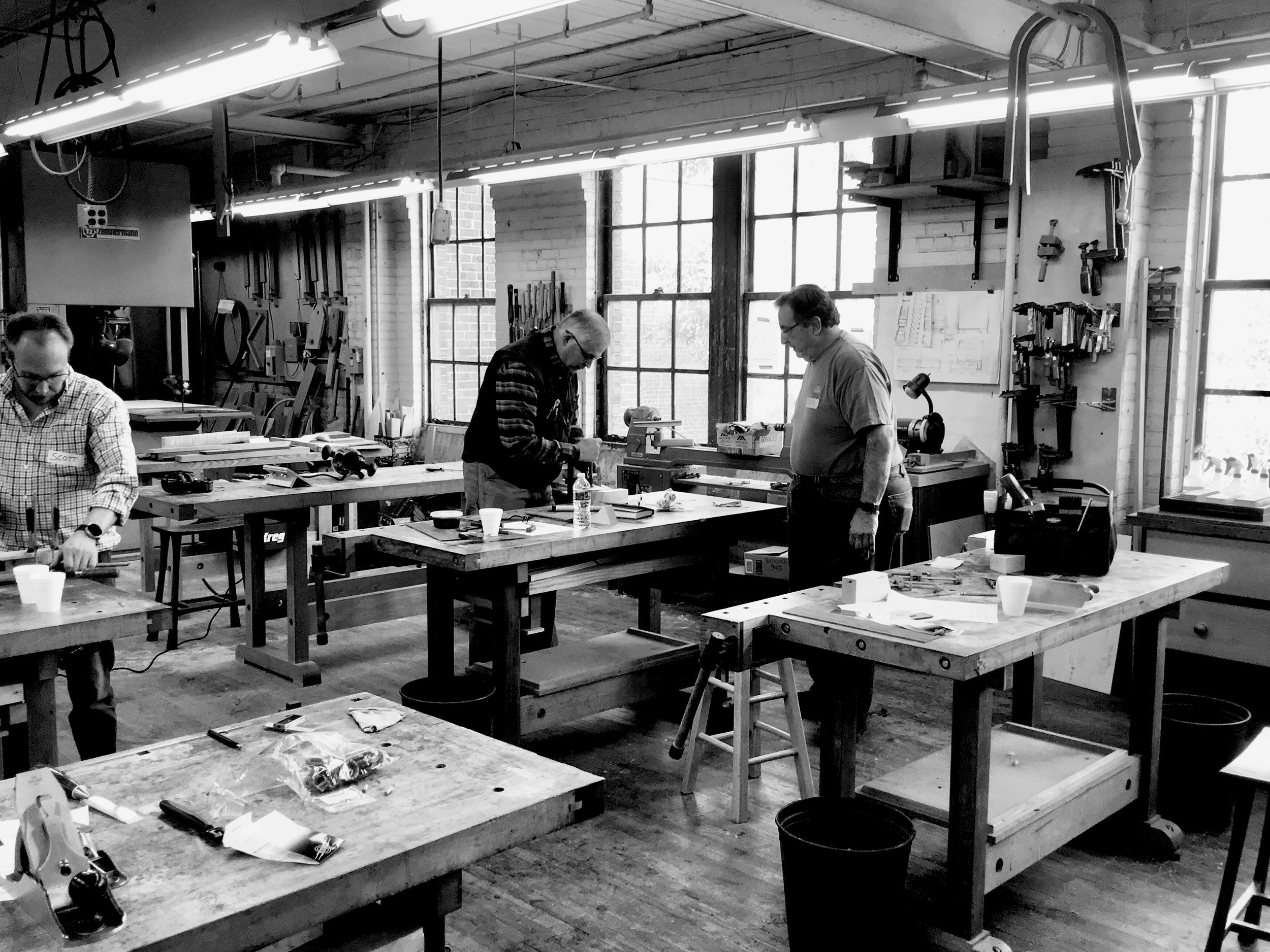 A well lit bench room with northern facing windows, 12 benches and a complete range of machines and hand tools