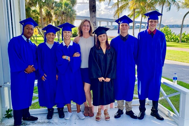 Six of our Palm City Graduates with therapist, Sarah Paulick