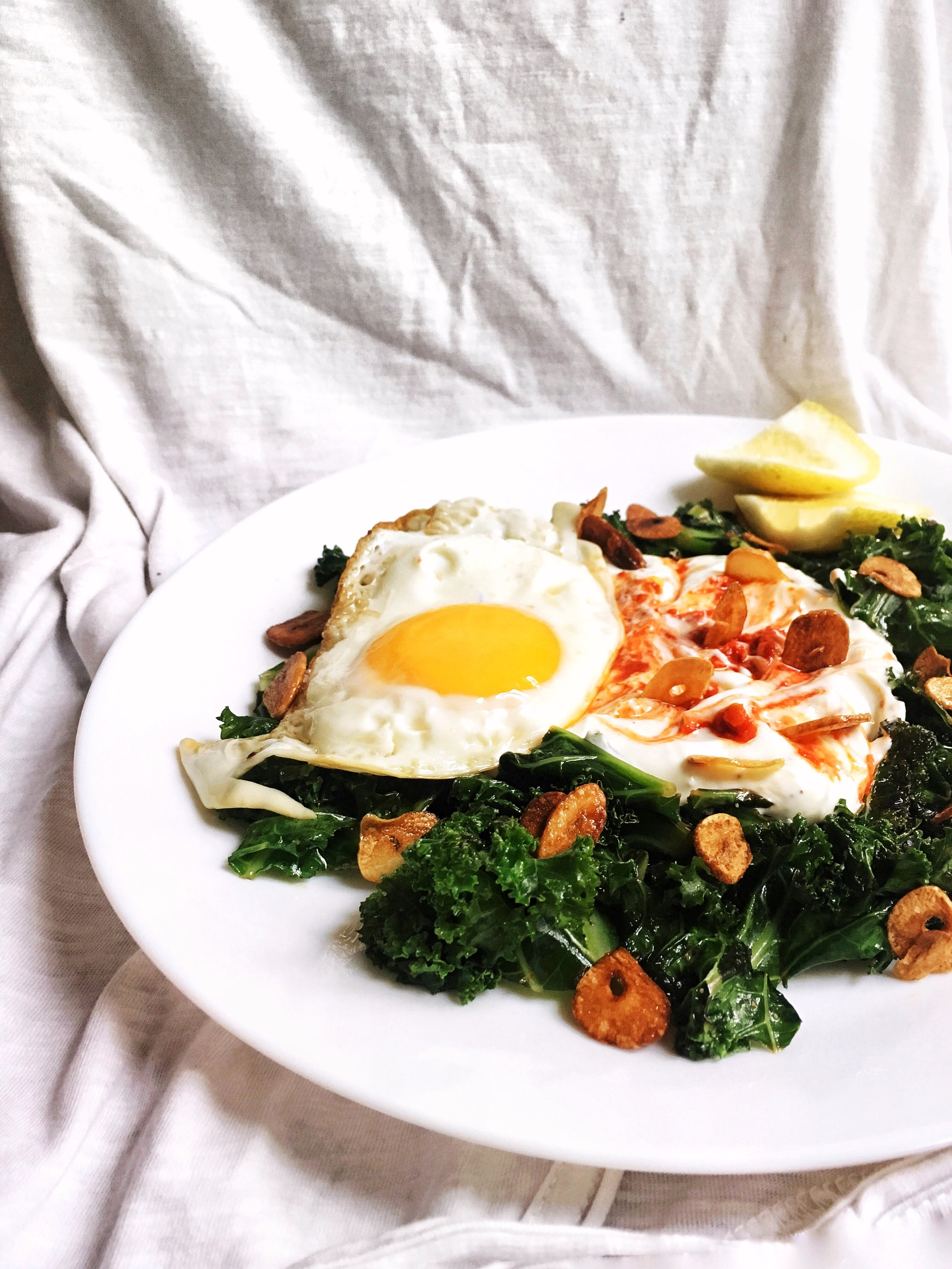Wilted Kale with Fried Garlic & Spiced Harissa Yogurt - Brad & Butter | June 18, 2019