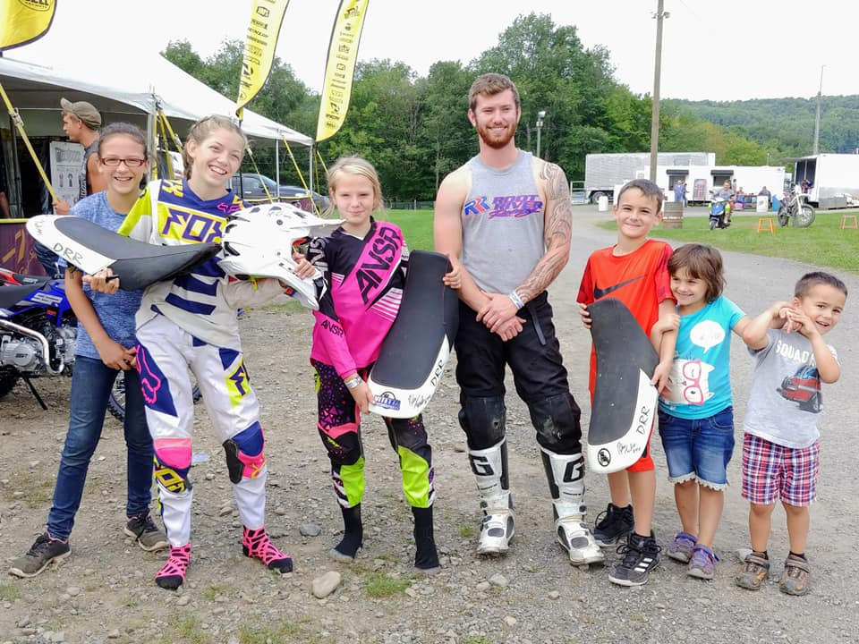 - Mini quad riders work with pro quad rider Dylan Tremellen of Root River Racing team at Unadilla Motocross on Sunday August 26th, 2018 - Photo credit Team Duncan #921 racing