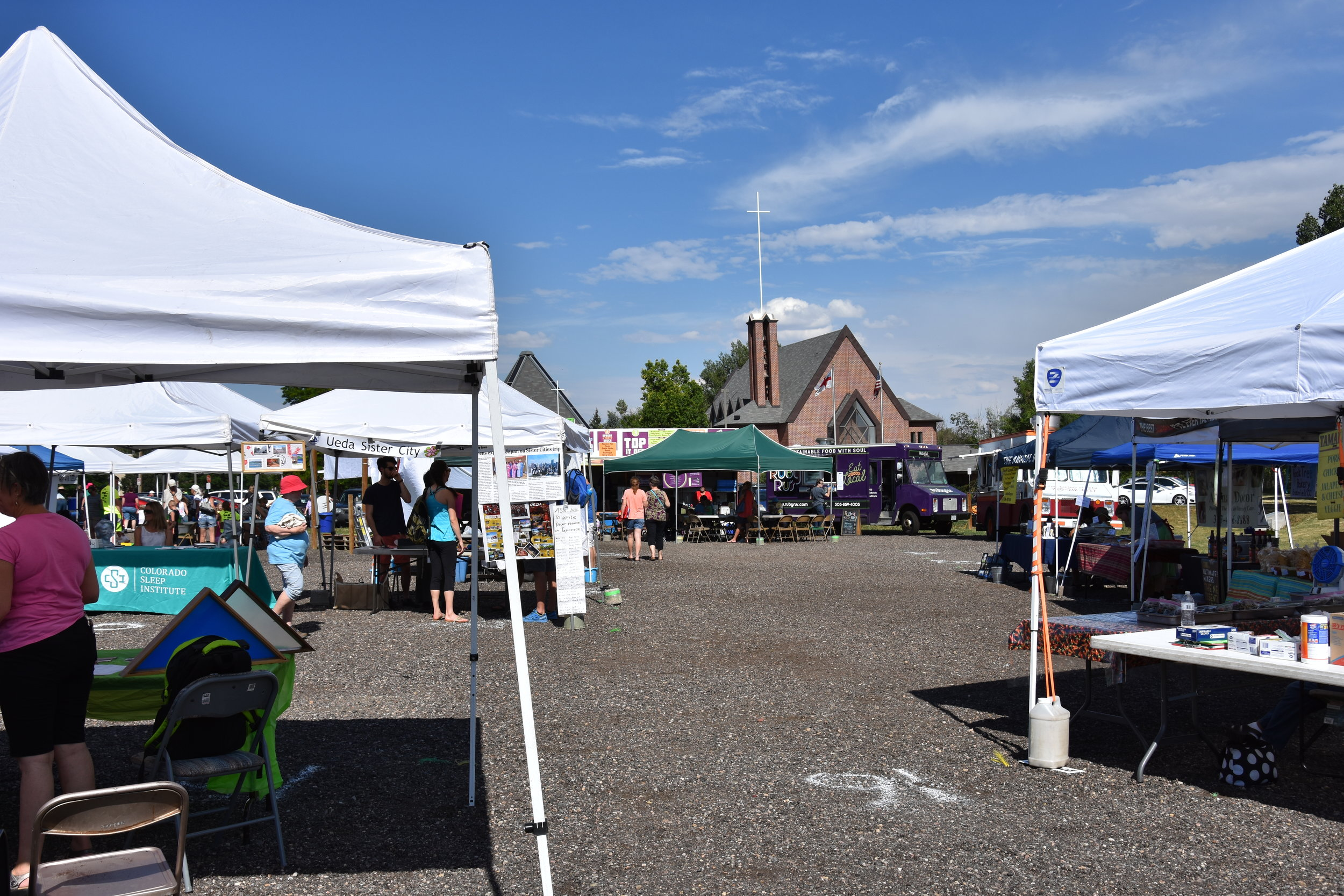 The community of Broomfield gathers at Holy Comforter for the weekly Farmers Market.