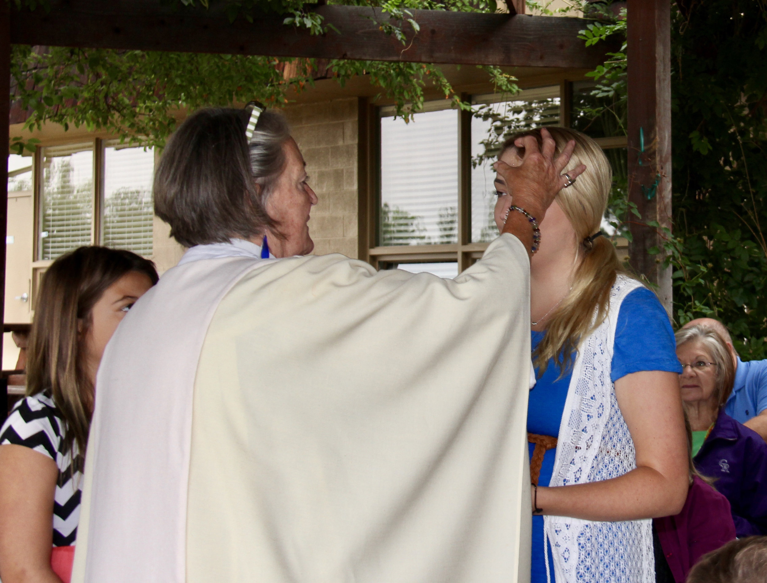 The Reverend Michele Quinn and parishioners celebrate baptisms at St. Joseph Episcopal Church in Lakewood. Photo courtesy Marlene Logan