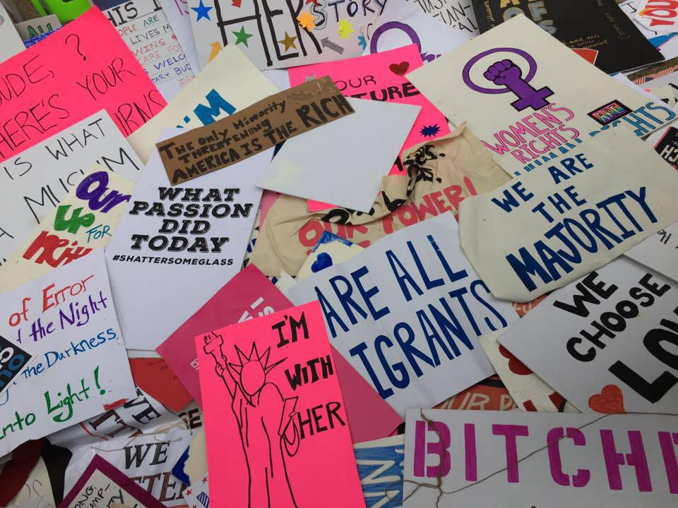 Protest signs scattered in the streets of Washington DC during the 2017 Women's March (Photo credit: Stephen Marro)
