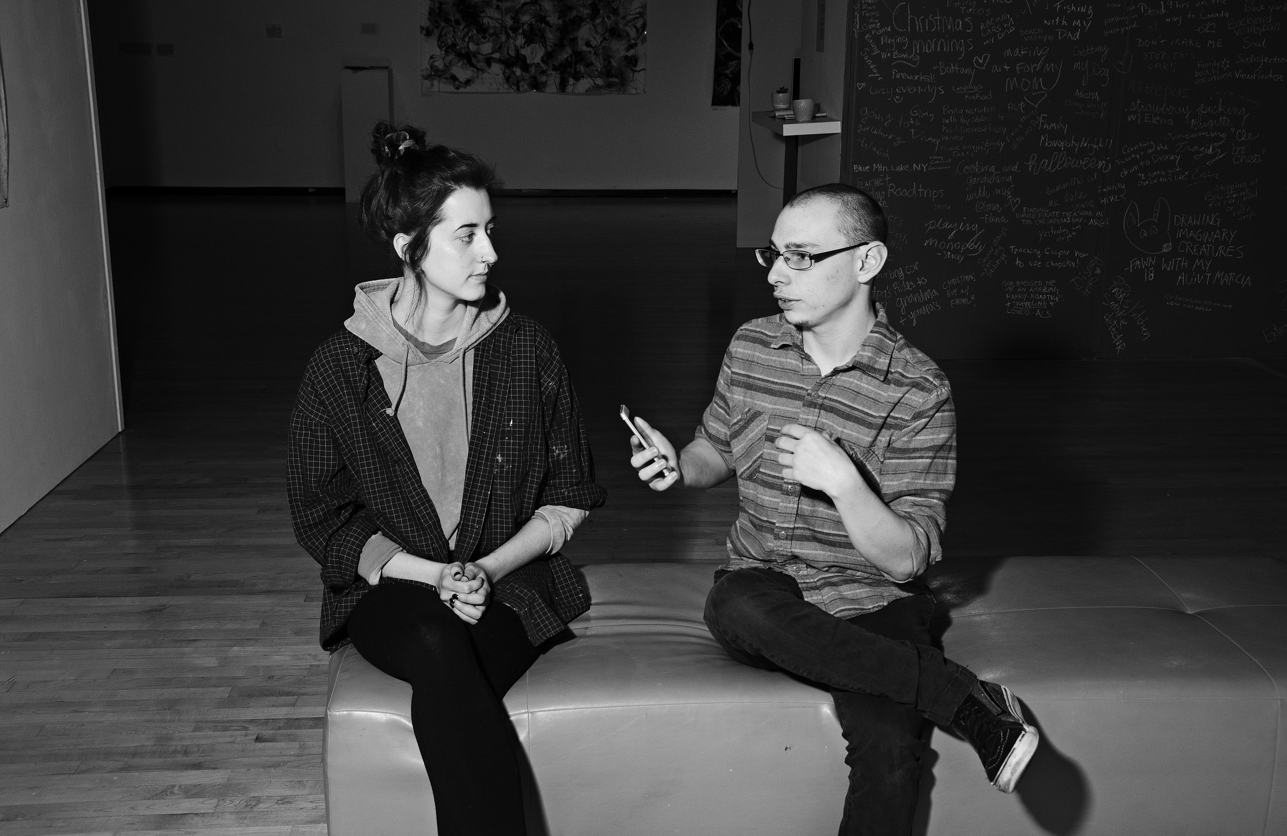 Chloe Collins (left) and Stephen Marro (right) interview at the Innocence exhibition (Photographer: Joshua Mason)