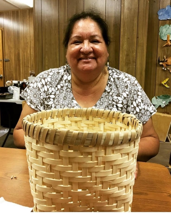 My mom and her corn-washing basket. Used to clean corn after the nixtamalization.