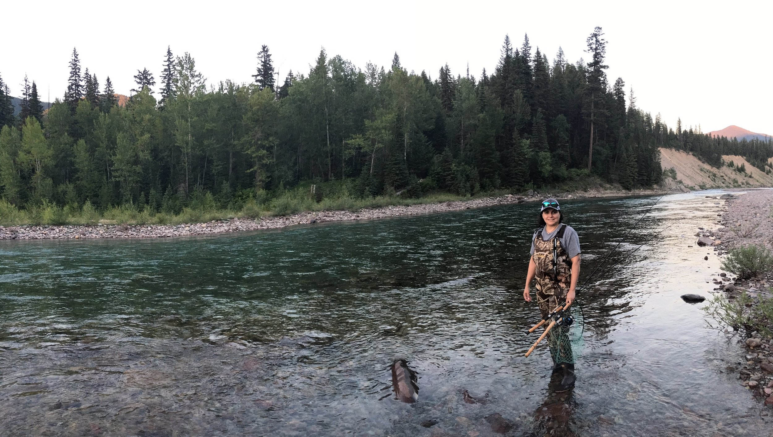 Aline steps into the Flathead River