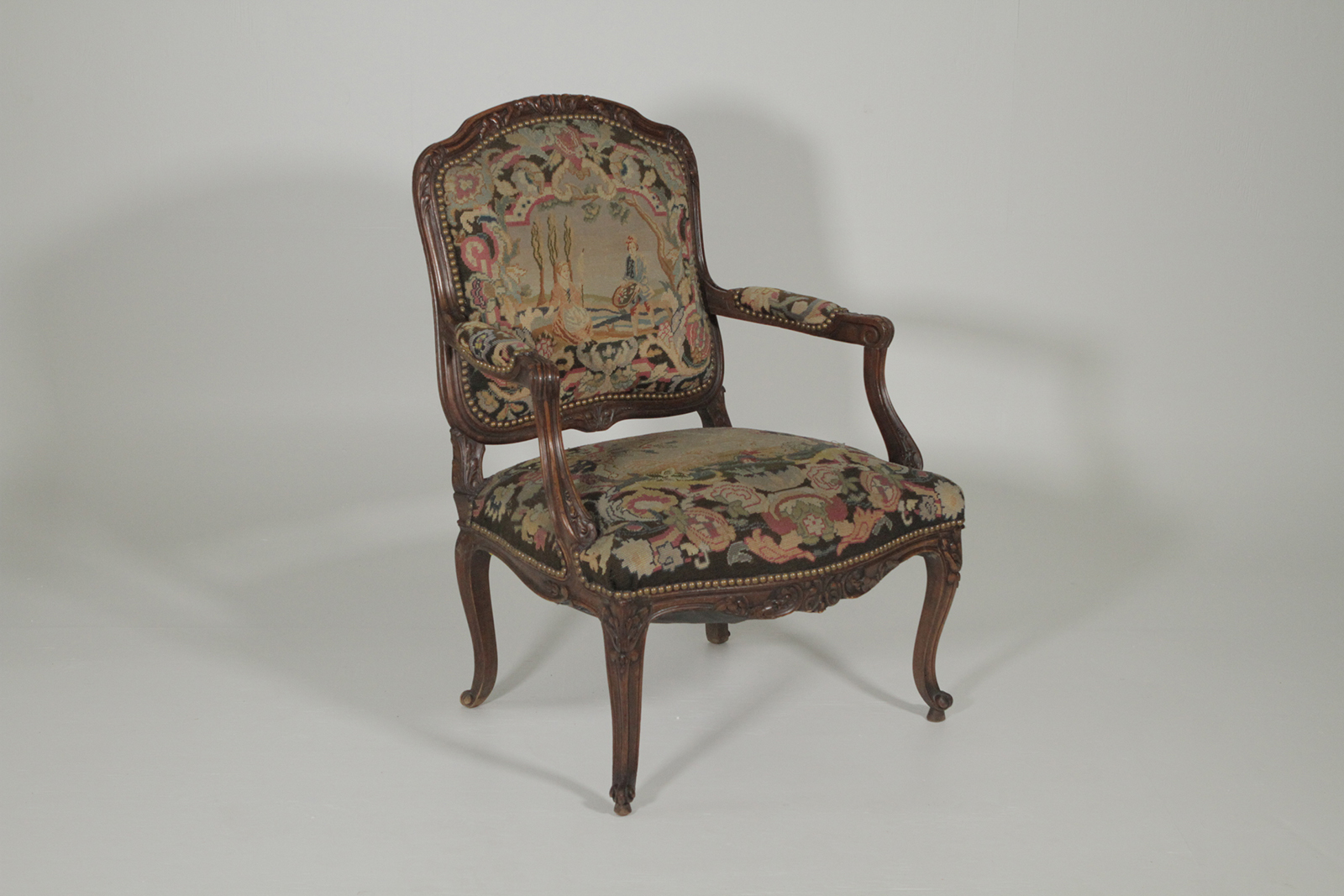 late 19th century hand carved french armchair with needlepoint tapestry
