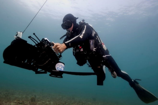 A CSA scientific diver performing a visual census of benthic substrate using innovative technology (Shark Navigator System).