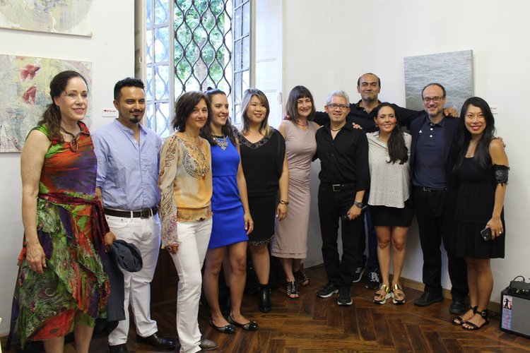 Artists with the museum director and curator for the opening night in Torino, Italy.