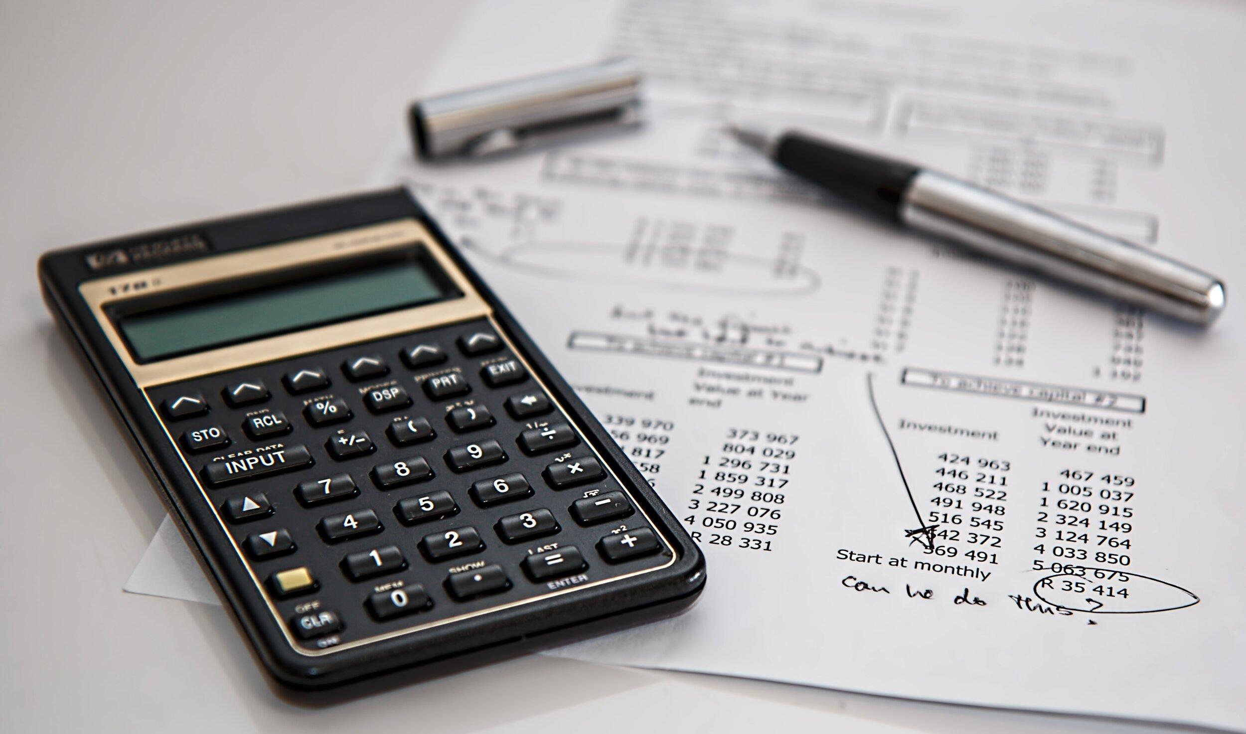 Canva - Black Calculator Near Ballpoint Pen on White Printed Paper.jpg