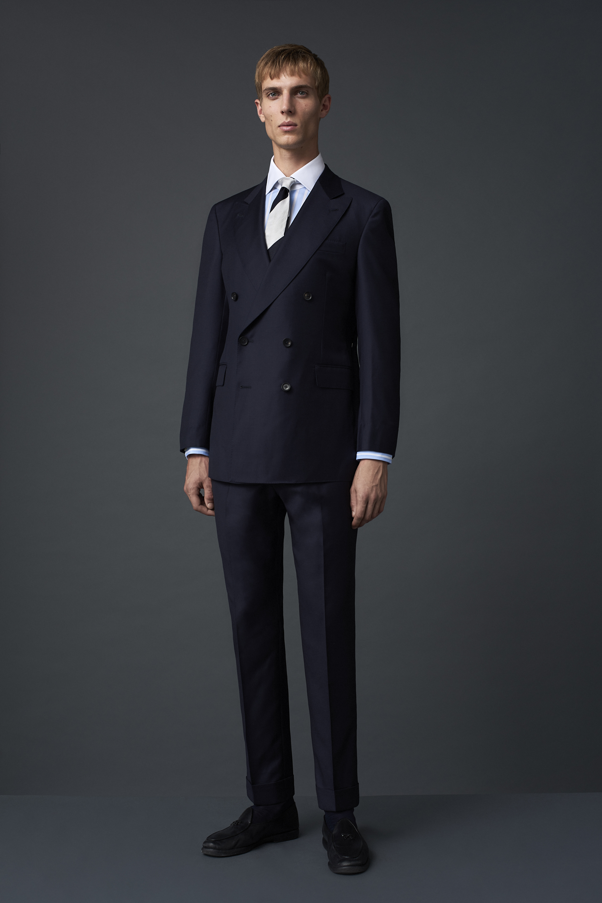 S130 merino double breasted suit woven in Biella, with dark buffalo horn buttons. Worn with a wide striped Egyptian cotton shirt with a contrast white collar and a thick silk twill tie woven in Italy.