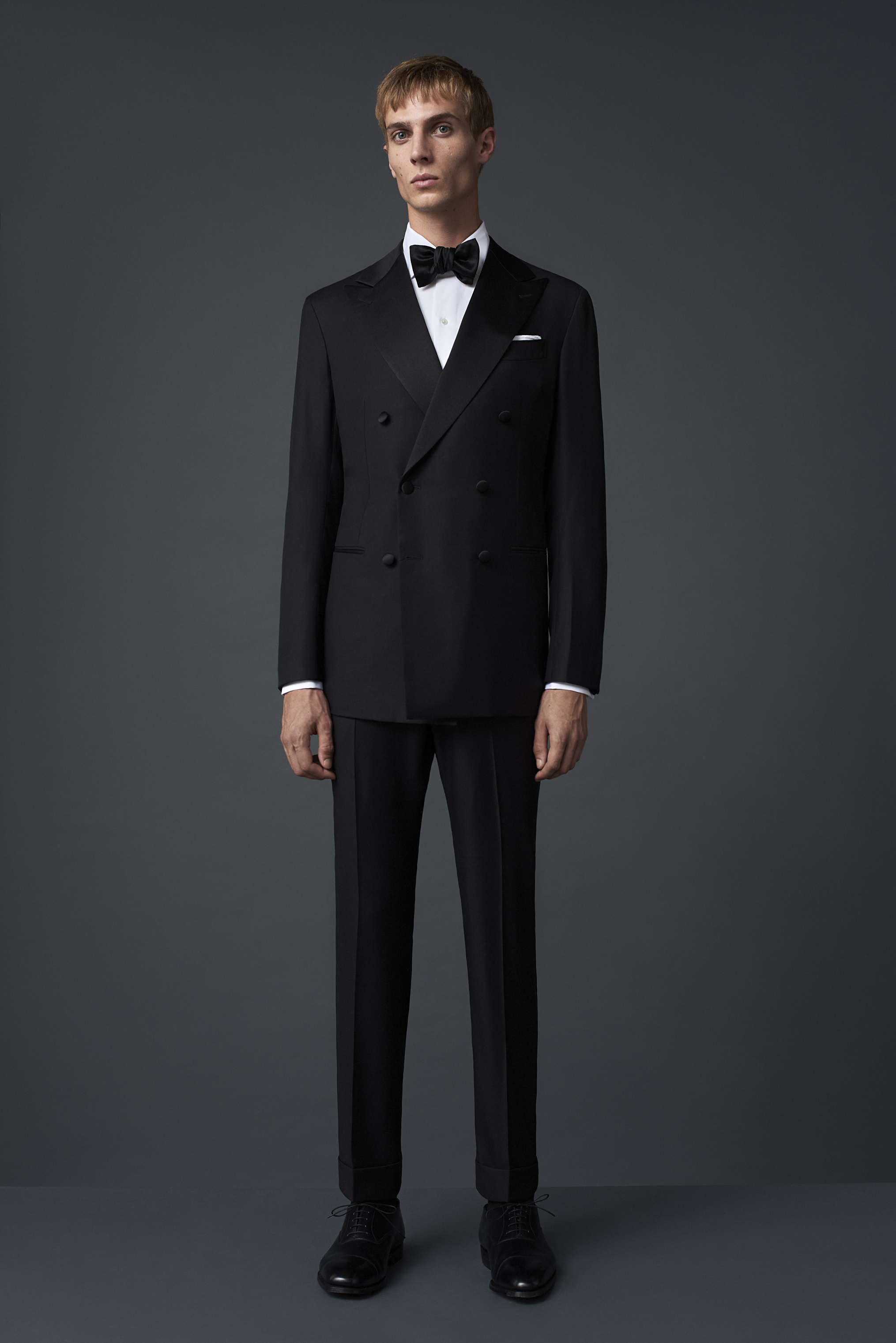 Black barathea 6x2 double breasted dinner suit woven in Biella, with satin facing. Worn with an Egyptian cotton dinner shirt with a marcella bib, and a classic satin bow tie.