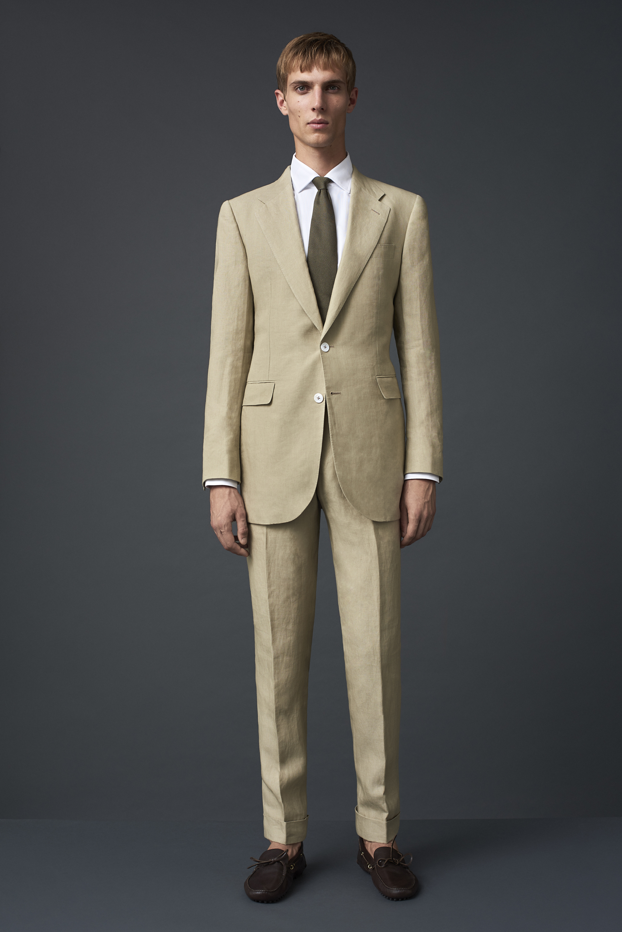 Beige Irish linen suit with white Australian mother of pearl buttons. Worn with a white Egyptian cotton shirt and a khaki grenadine tie.
