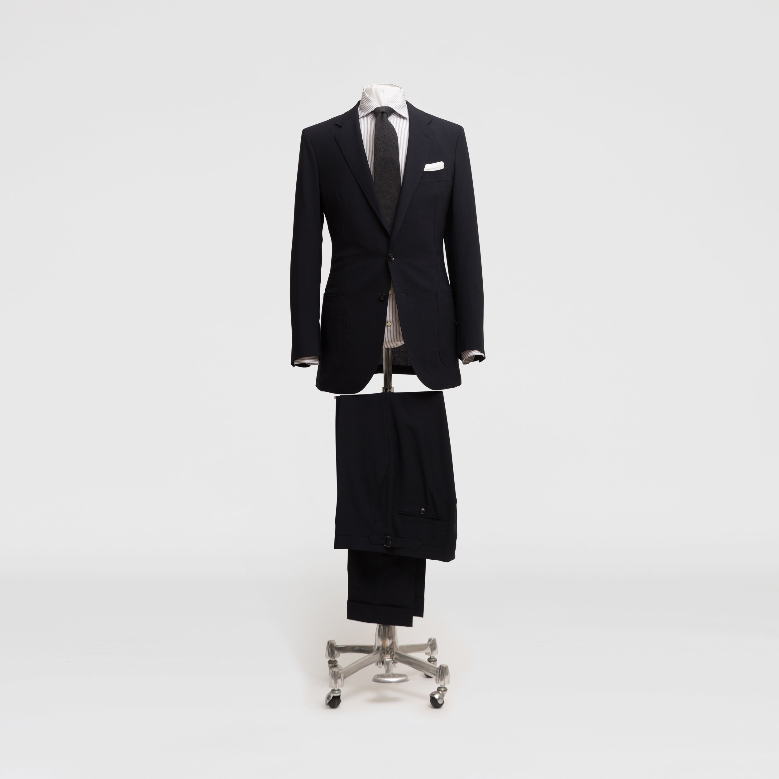 Perfect for a formal office, pair with the suit trousers, a crisp Egyptian cotton shirt and a dark, centering tie. Classic leather shoes and a white linen pocket square will round off the look.