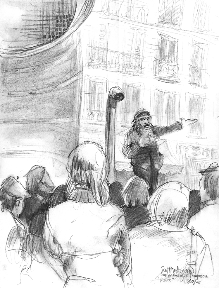 A citizen lecturing the crowd from his soapbox on the square in front of the George Pompideu art museum, Paris.
