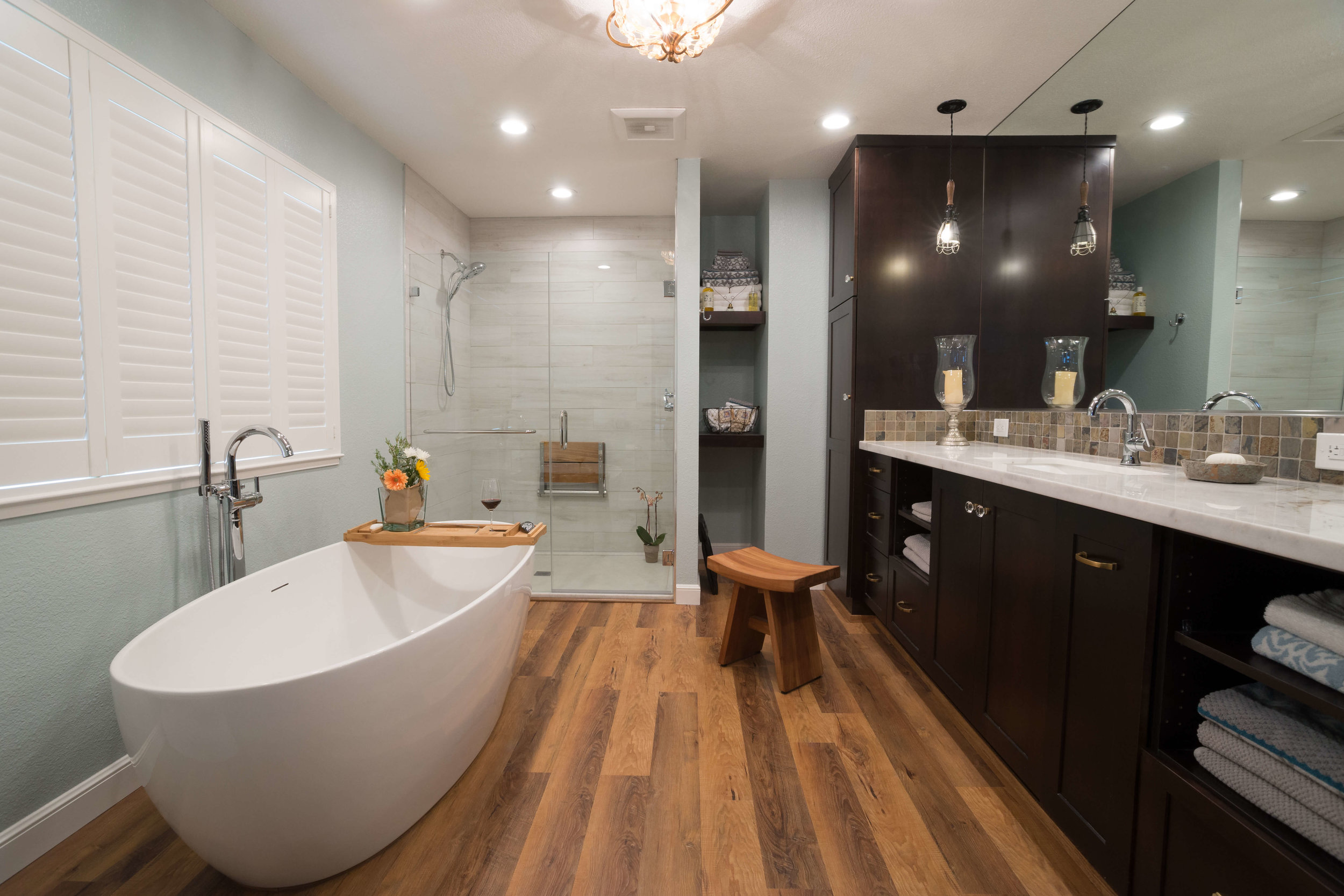 New master bathroom layout with luxury vinyl tile flooring, spacious tub and elegant shower