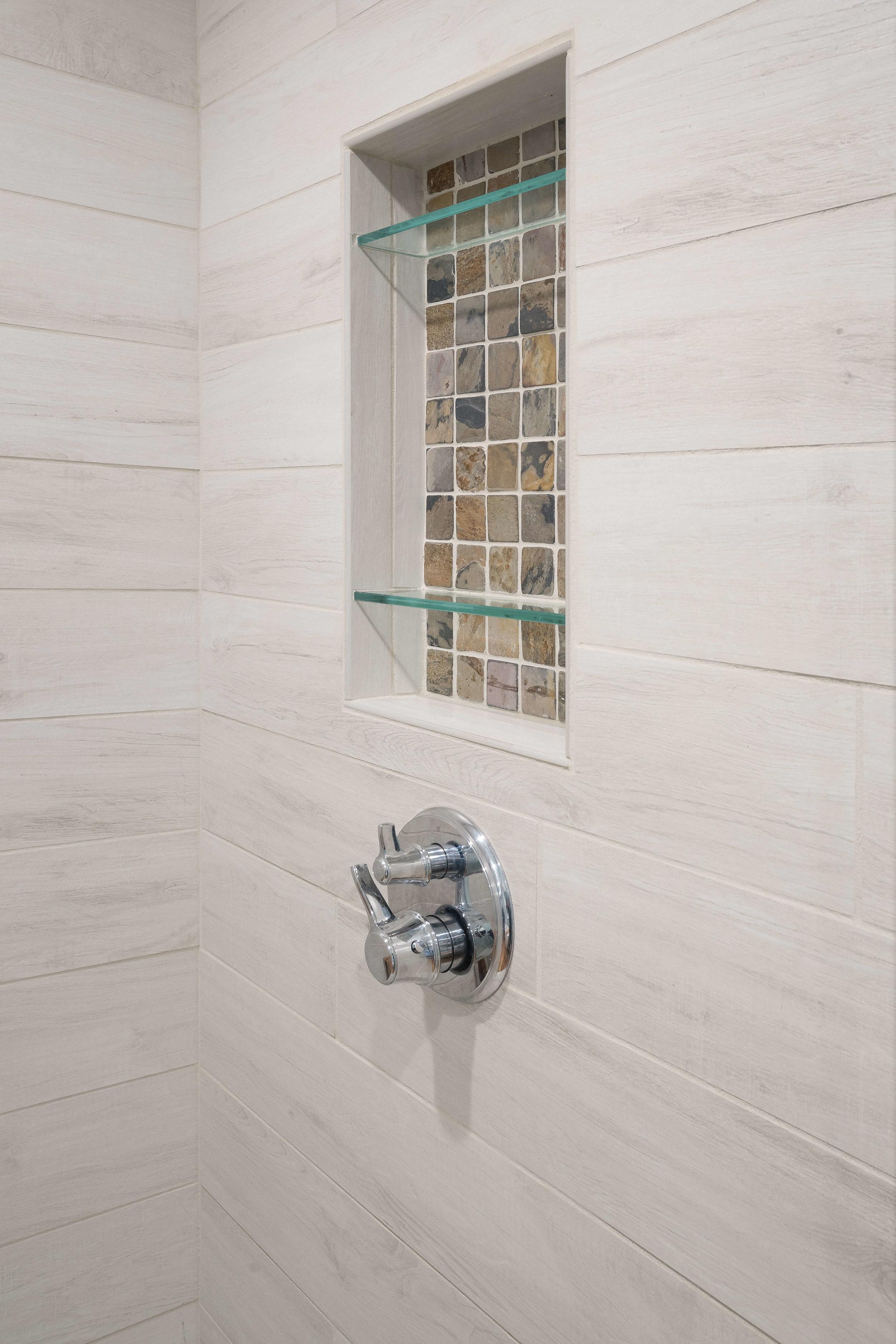 Design detail: Recessed shower niche tile echoes the vanity backsplash.