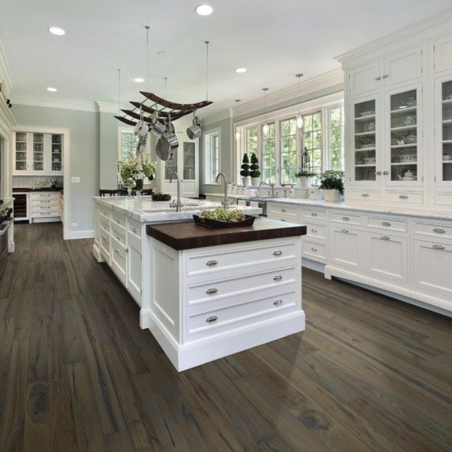 Dark flooring adds depth, drama and practicality to the home.