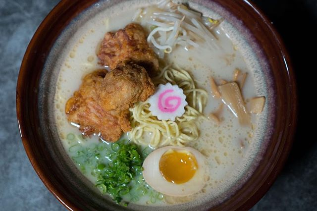 """Calling all chicken fans! The """"Let's Get Physical"""" Fried Chicken Ramen is our take on Southern meets Japan. This hot n' heavy union includes slow-cooked chicken broth, bean sprouts, green onions, half-seasoned egg, bamboo shoots, Naruto, and thin noodles."""