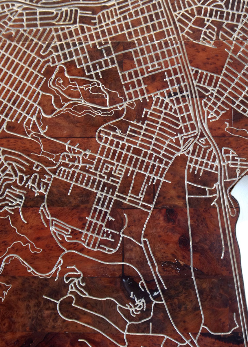 The Dogpatch - (left and above)Burl redwood and stainless steel street map of the Bay Area, highlighting The Pearl's location in San Francisco's Dogpatch district.