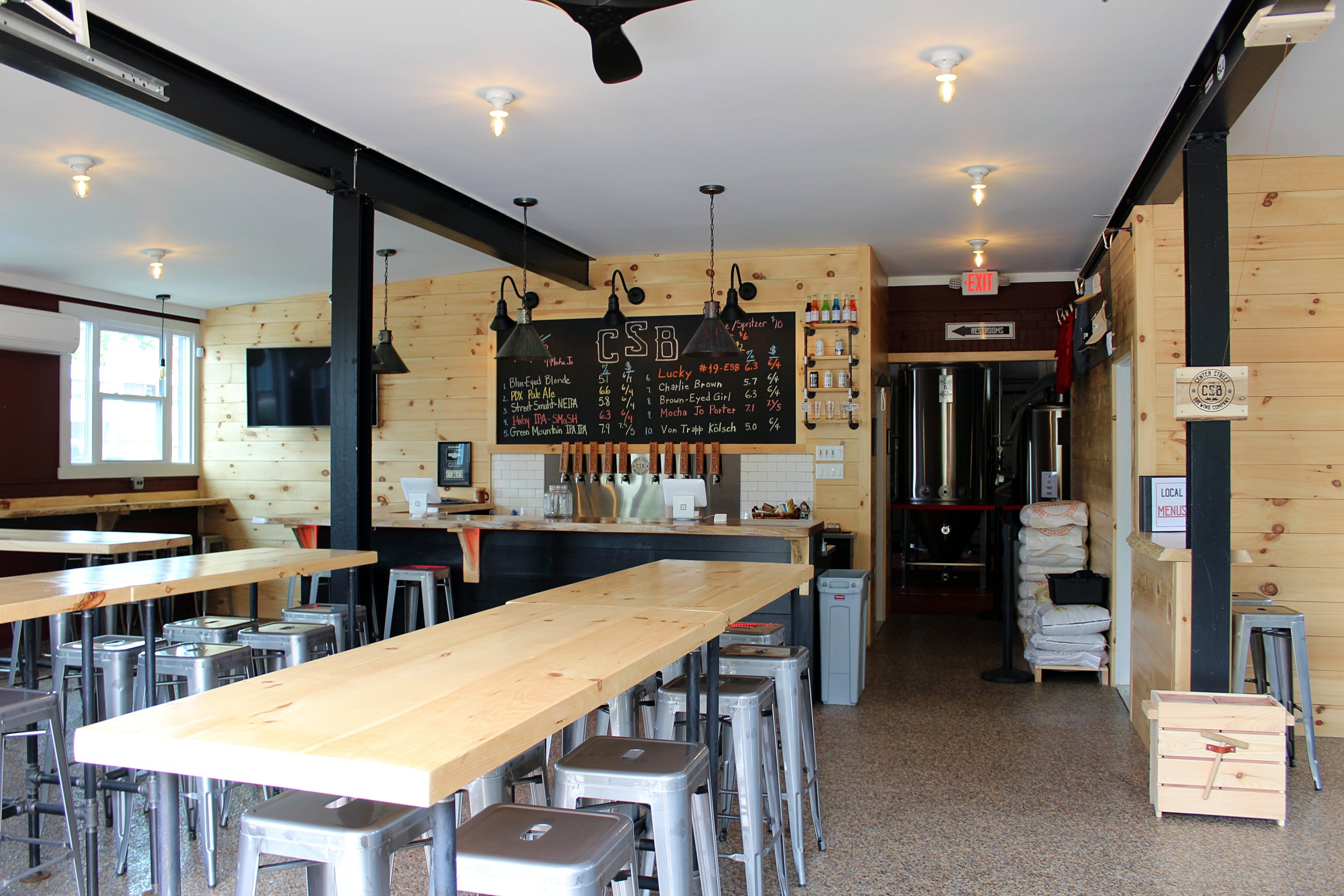 The goal of our taproom was to create a warm and inviting environment that replicates the vibe of a New England barn; a great place to enjoy the company of friends