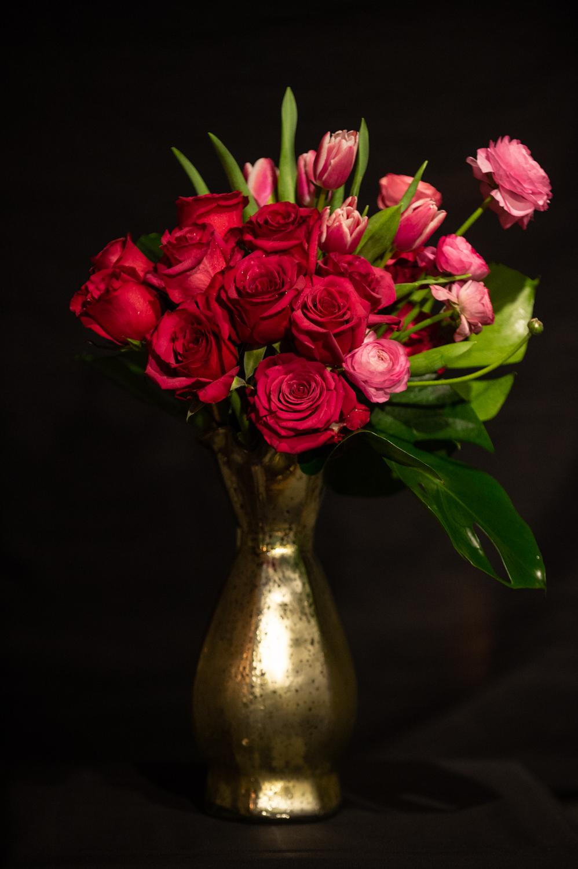 -12 parts rose-6 parts tulip-ranunculus dashmonstera garnish -