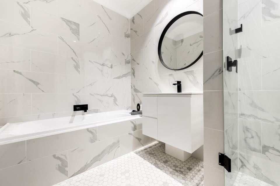 Featuring DC Architecture private residence with our calcatta marble tiles & mosaic feature tiles