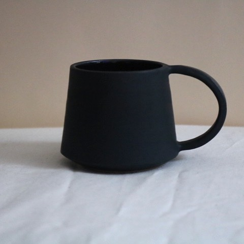 When it comes to my design style, I'm obviously a minimalist. I think a lot (probably too much) about clean lines and proportion. I just think that there is so much beauty in simplicity. Ironically, creating simple pieces is a non-simple process that requires tons of precise shaping and measuring 🤷🏾♀️ Anyway, these beautifully simple/complicated Bell Mugs are available in the shop! Take a look at the video below for a peek at my process for creating this mug form on the wheel 🤗