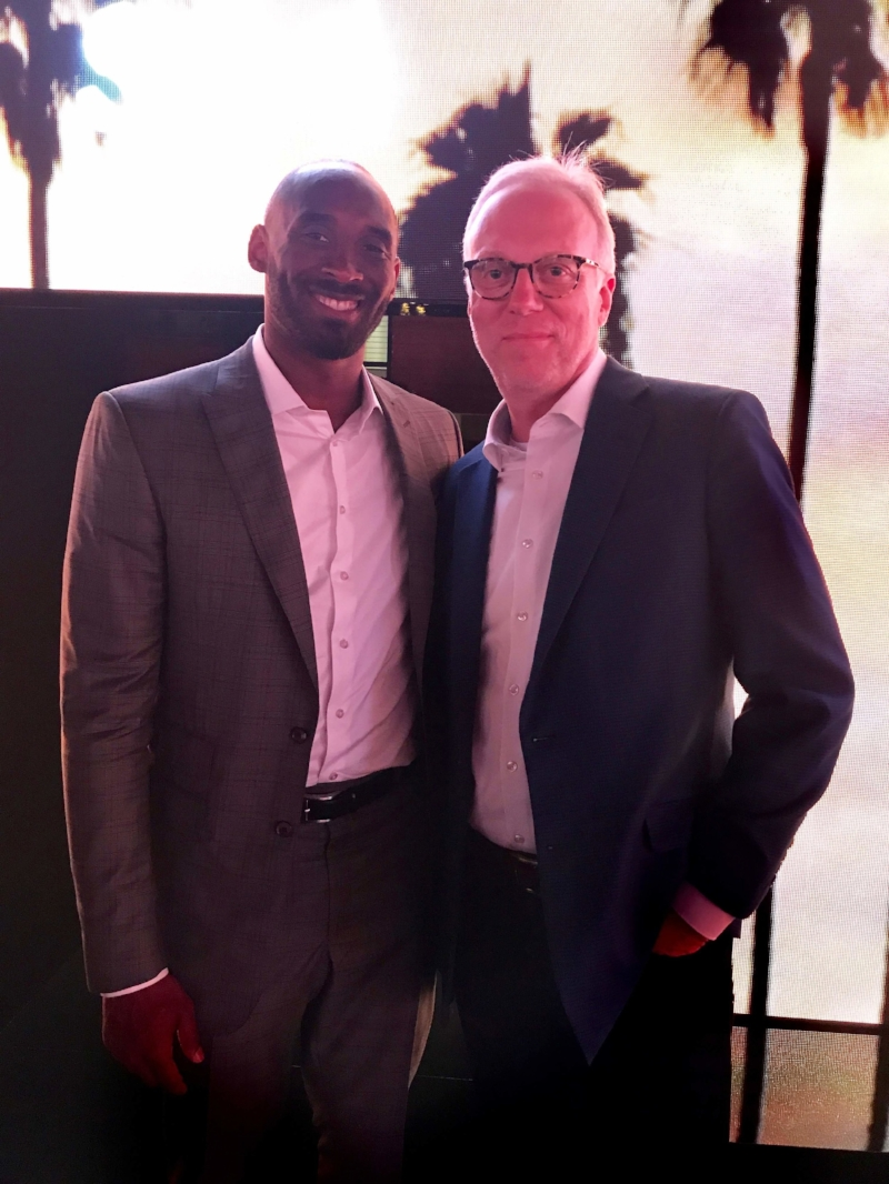 Kobe Bryant and some old dude with a huge head.