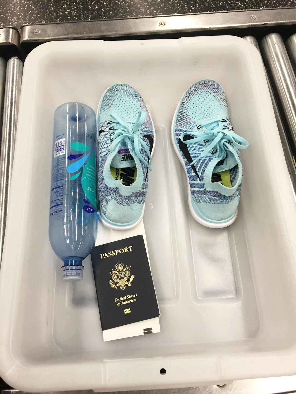 airport security bin - passport -bottle- nike.jpg