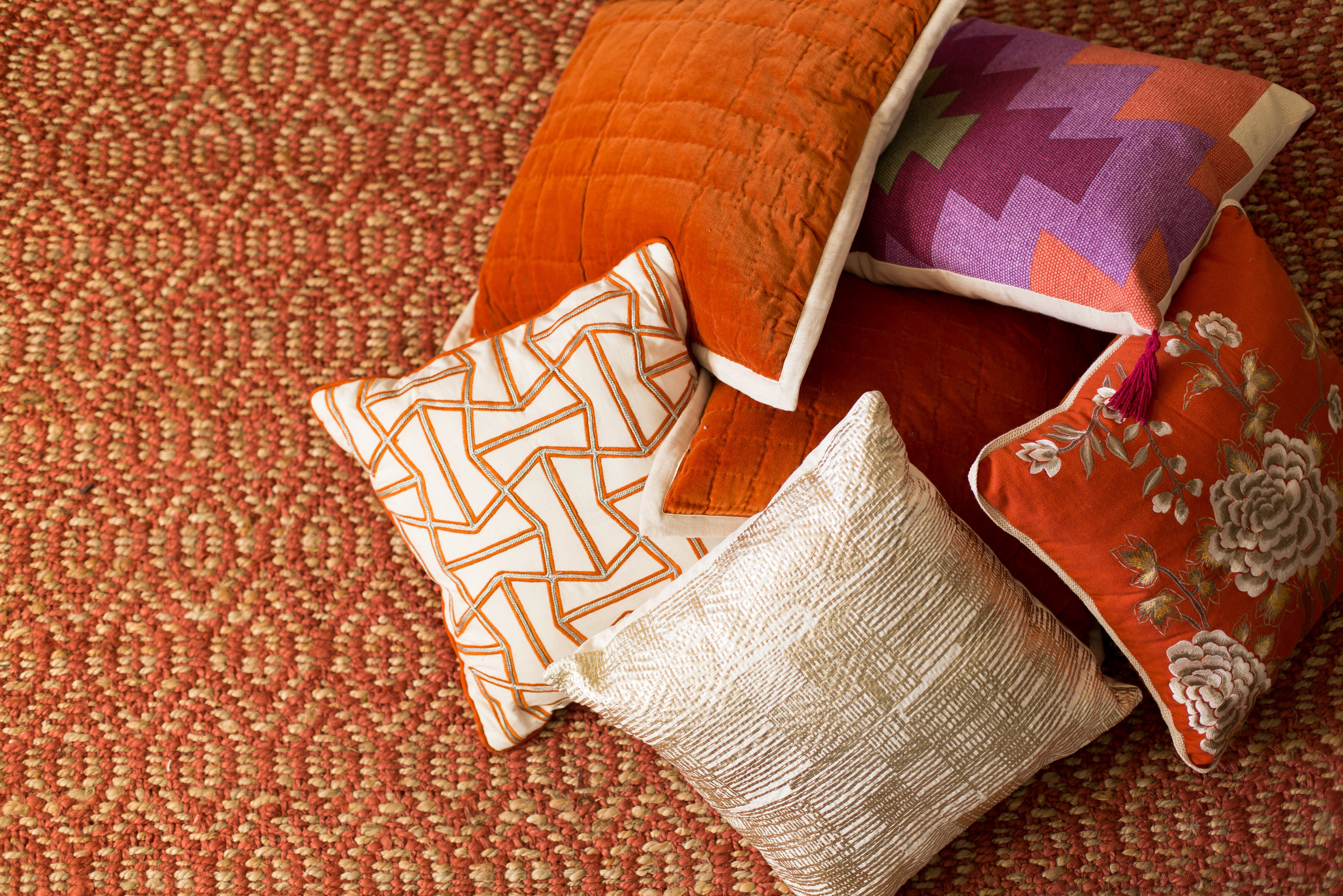 Dayka Robinson Budget Decorating pattern mix rust sisal pillows.jpg