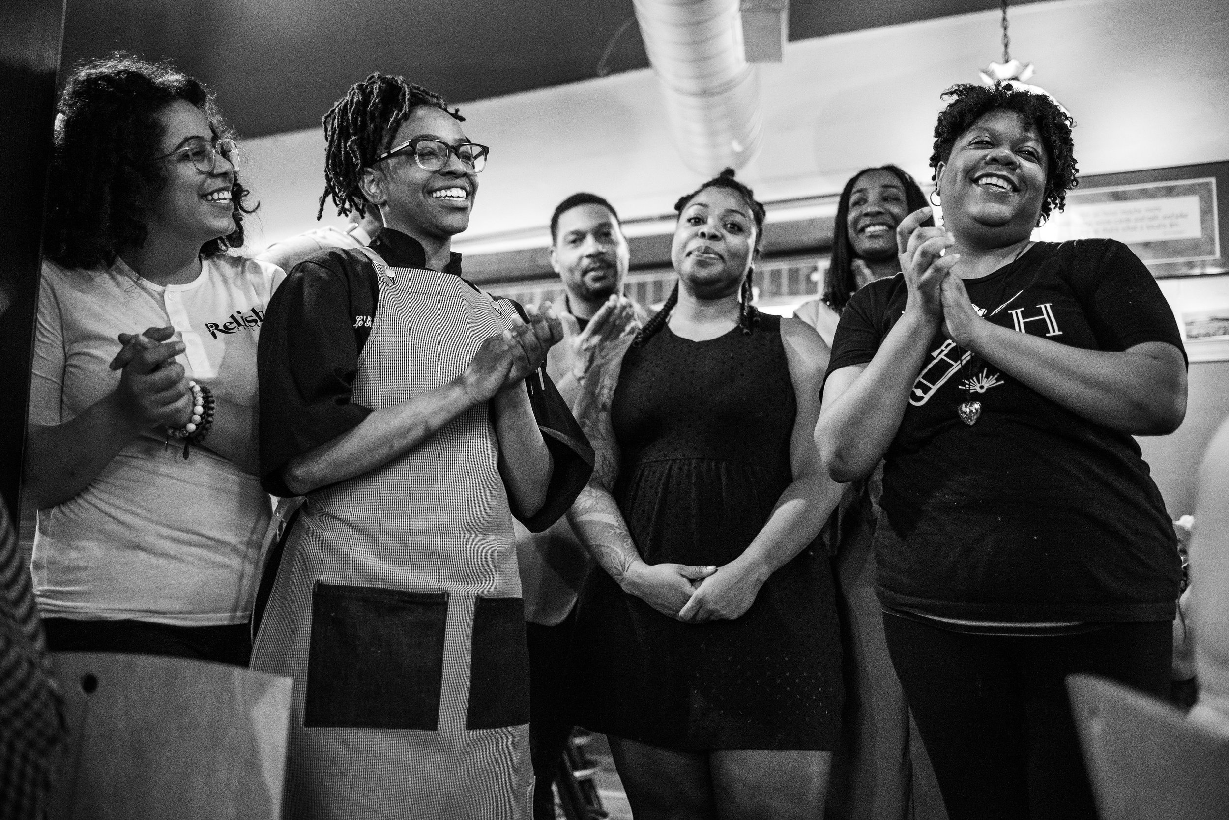 Brittiany Peeler (far left) and Le'Genevieve Squires (second from left) of Relish Catering. Viana Rickett (center) of Simple Goodness. Lauren Daniels (second from right) of Sumptuous Spirits. Ederique Goudia (far right) of Gabriel Hall.